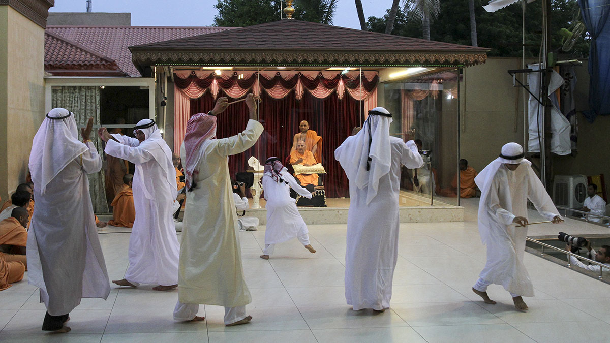 Devotees from UAE perform a cultural dance before Swamishri
