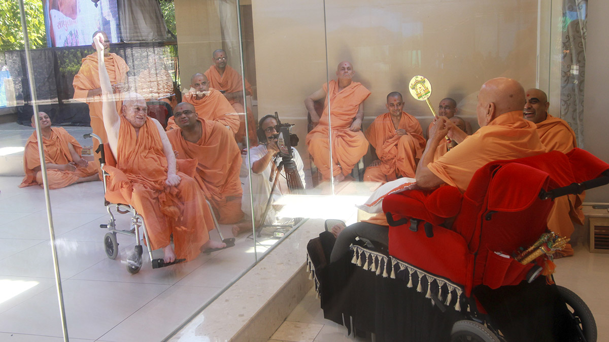 Devcharan Swami rejoices before Swamishri