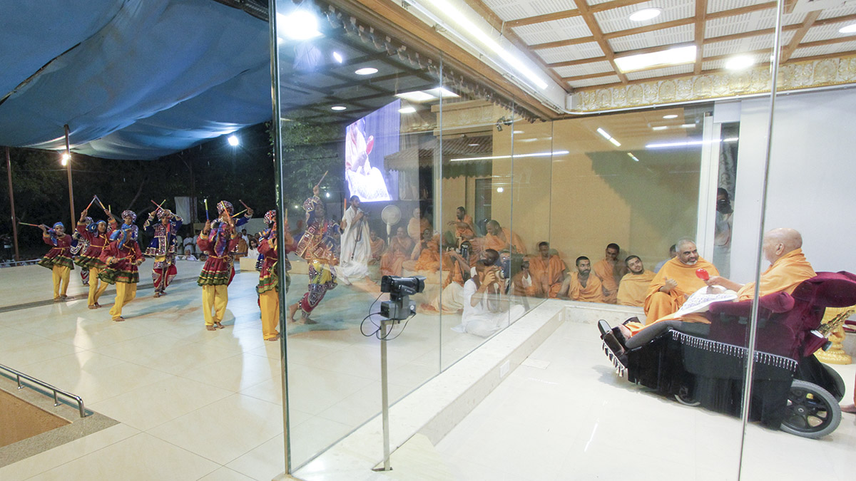 BAPS children from Ahmedabad perform a cultural dance before Swamishri