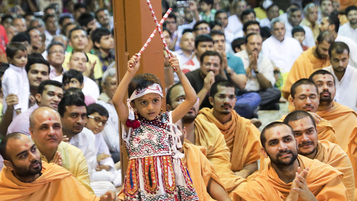 A child rejoices before Swamishri