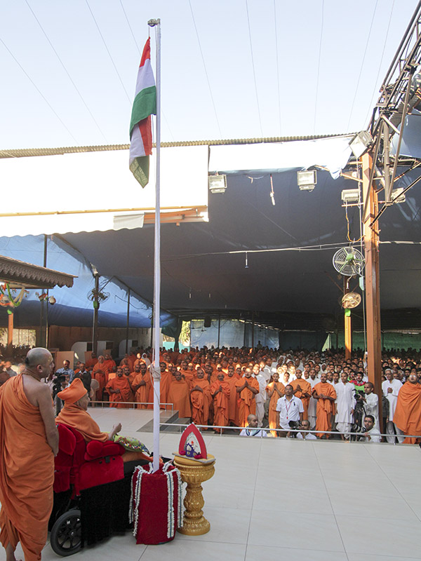 Sadhus and devotees participate in flag hoisting ceremony