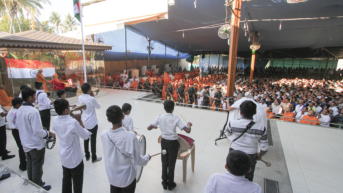 Parade by children before Swamishri