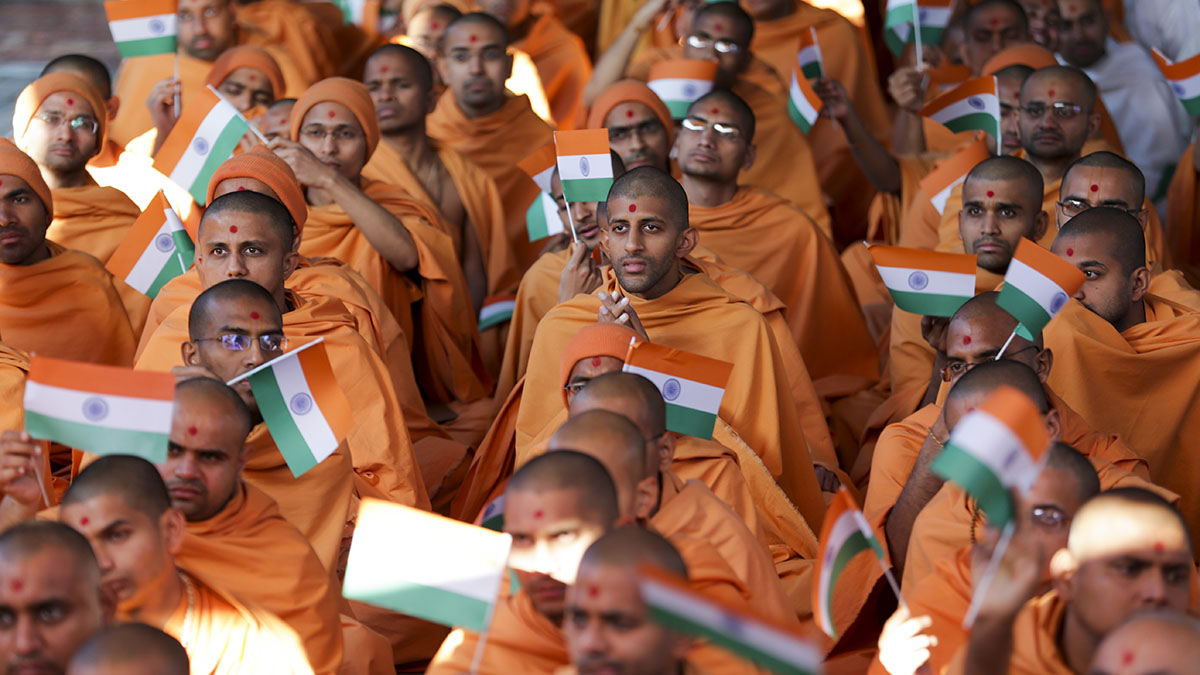 Sadhus wave the Indian tricolor