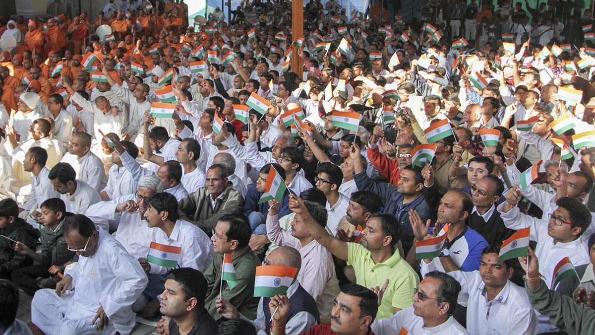 Devotees wave the Indian tricolor