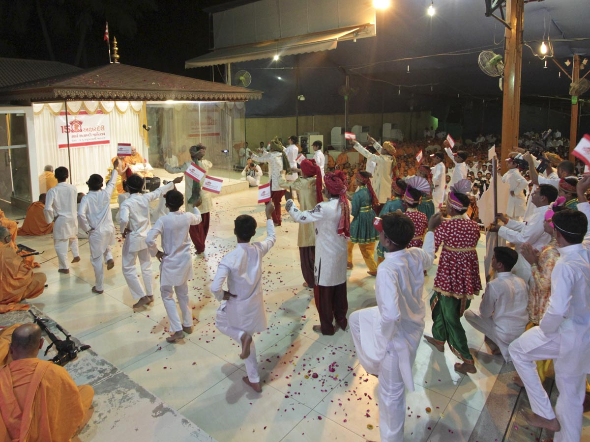 Youths and children perform a cultural dance