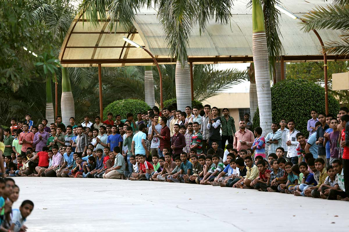 Children doing darshan in the school campus
