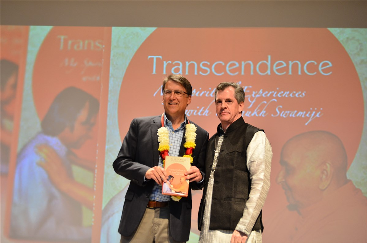 Mayor Stohlman presenting 'Transcendence' to Governor McCrory.
