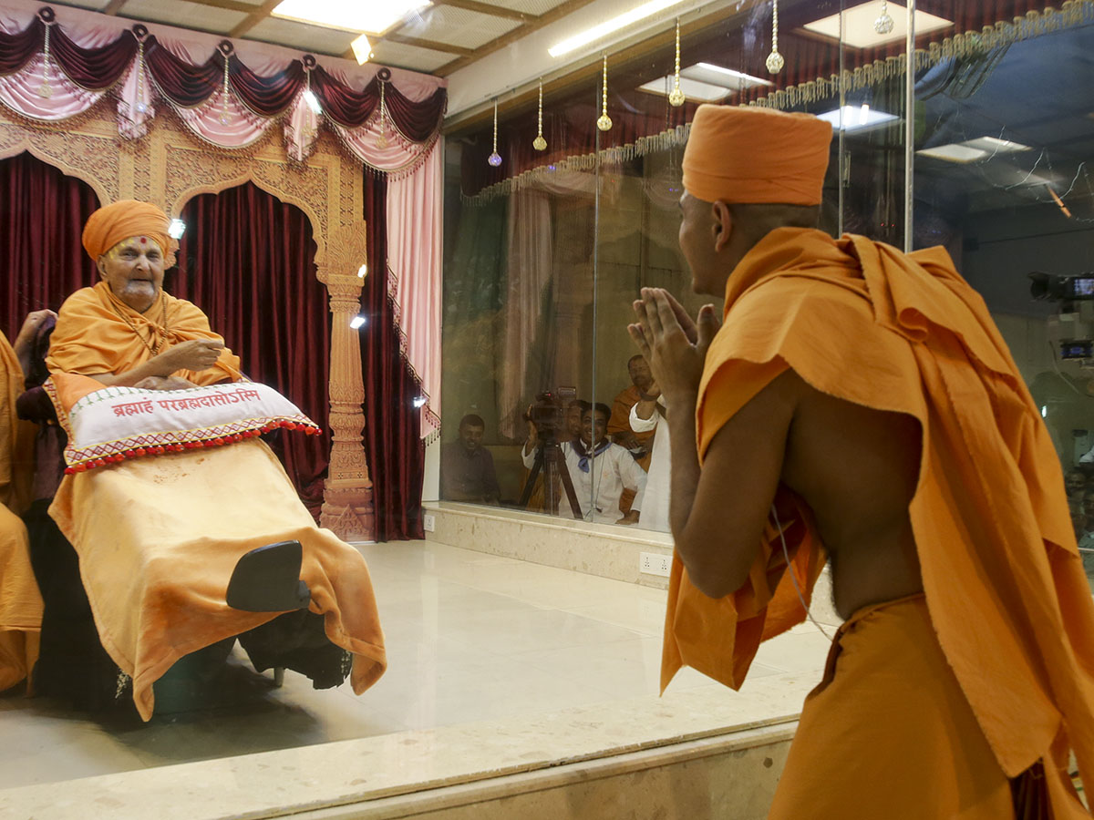 Swamishri blesses the newly initiated sadhus