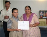 Student being falicitated by officials and guests