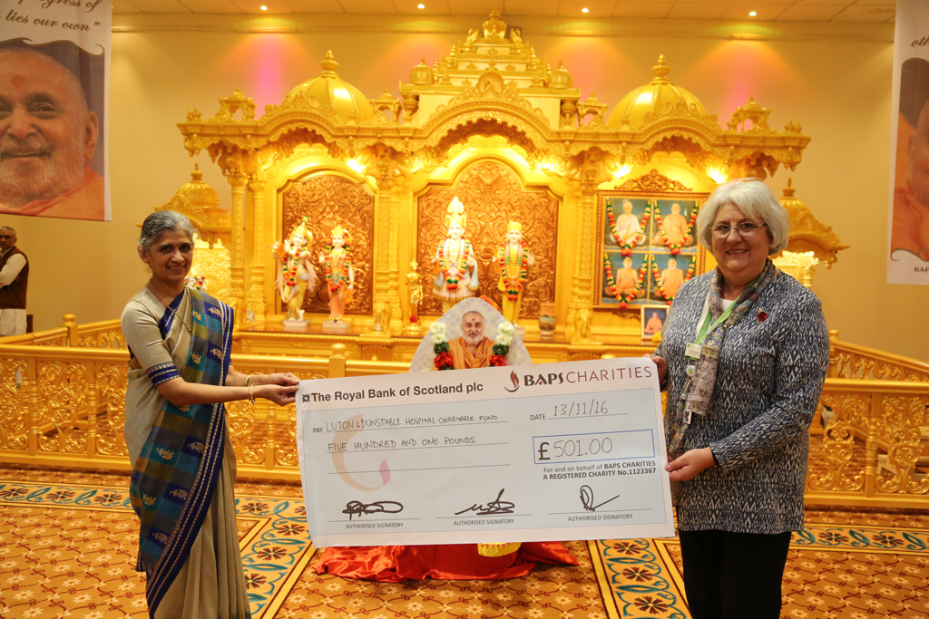 A cheque for £501 presented to Luton & Dunstable Hospital raised by BAPS Charities in Luton