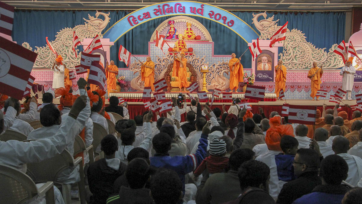 Param Pujya Mahant Swami Maharaj and sadhus wave BAPS flags, 10 Feb 2017