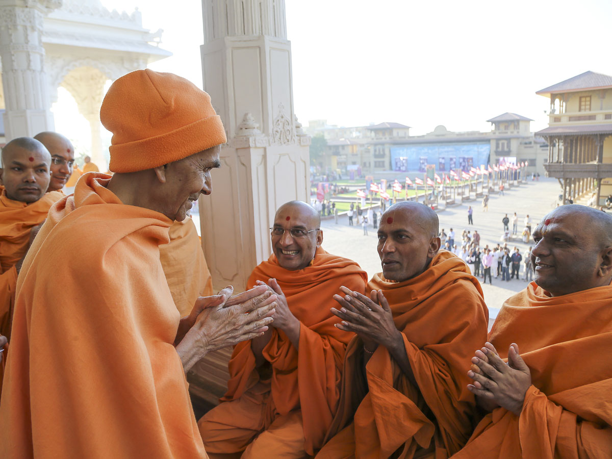 Param Pujya Mahant Swami Maharaj converses with sadhus in the mandir pradakshina, 10 Feb 2017