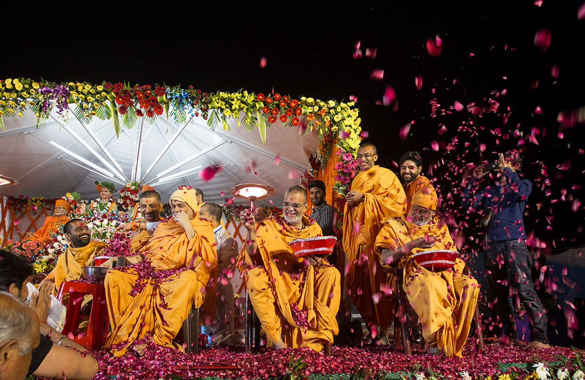 Senior sadhus shower flower petals on devotees, 3 March 2017