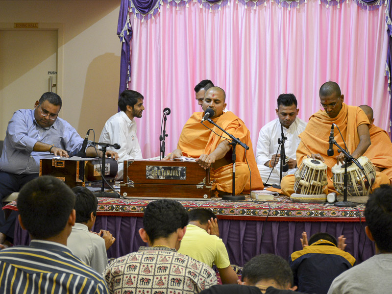 Sadhus and youths sing kirtans