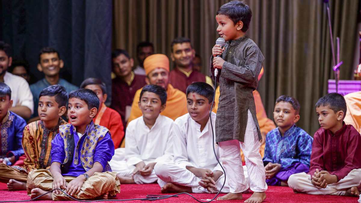 A child presents before Swamishri, 7 Apr 2017