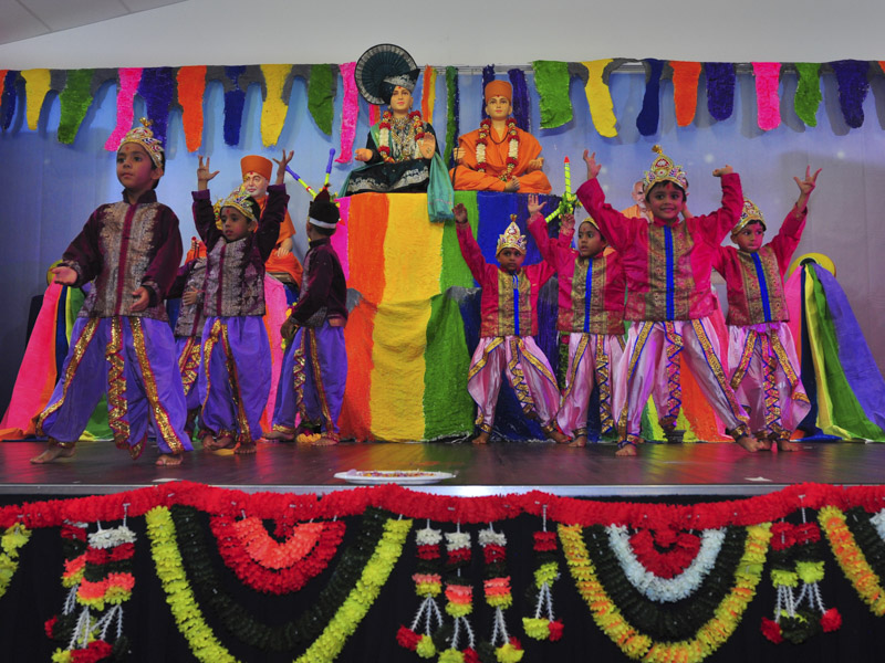 Children perform a cultural dance in pushpadolotsav assembly