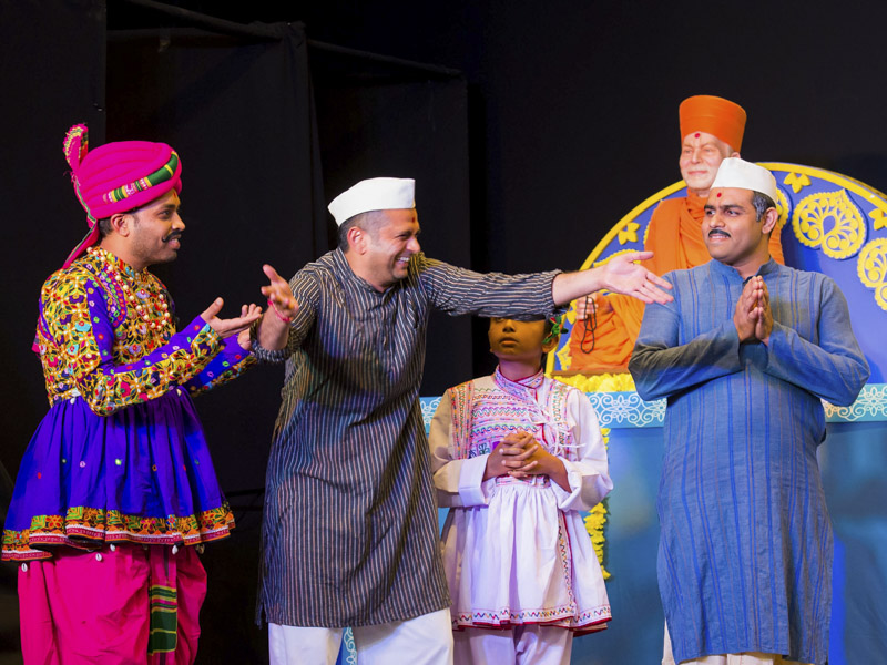 A skit presentation by devotees in the welcome assembly