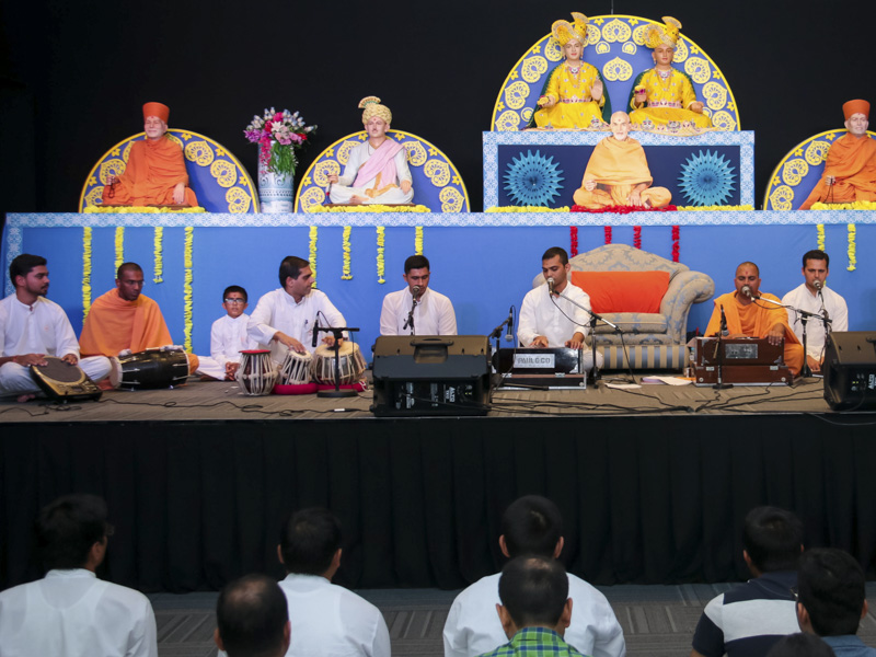 Sadhus and youths sing kirtans in the kirtan aradhana assembly