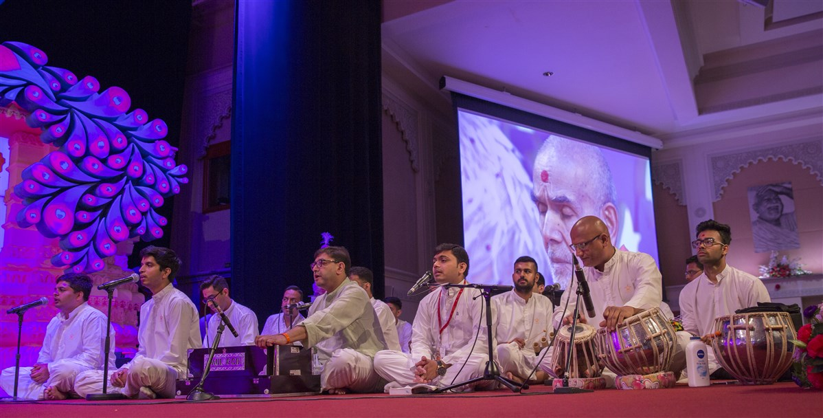Youths present bhajans in Swamishri's puja