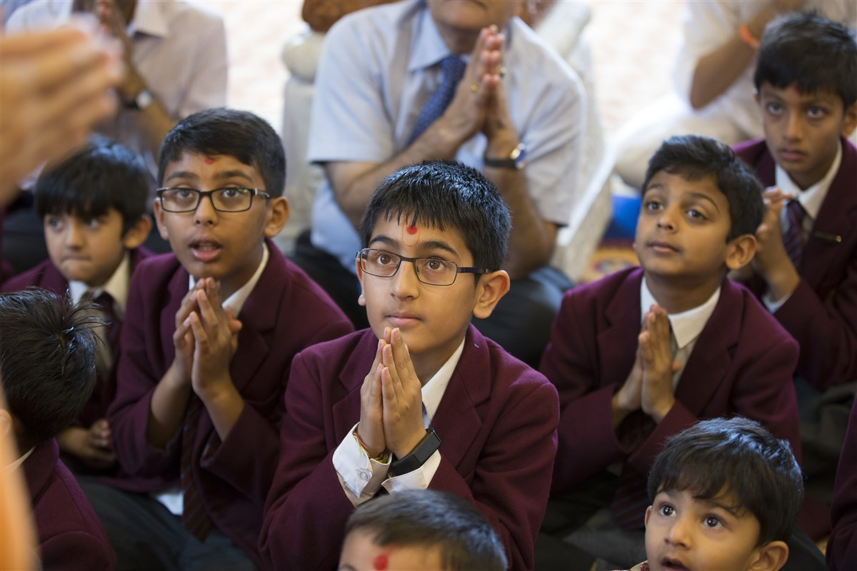 Pupils of The Swaminarayan School remain enraptured in Swamishri's darshan