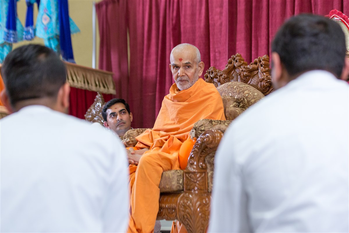 Swamishri attentively listens to program conducted by youths
