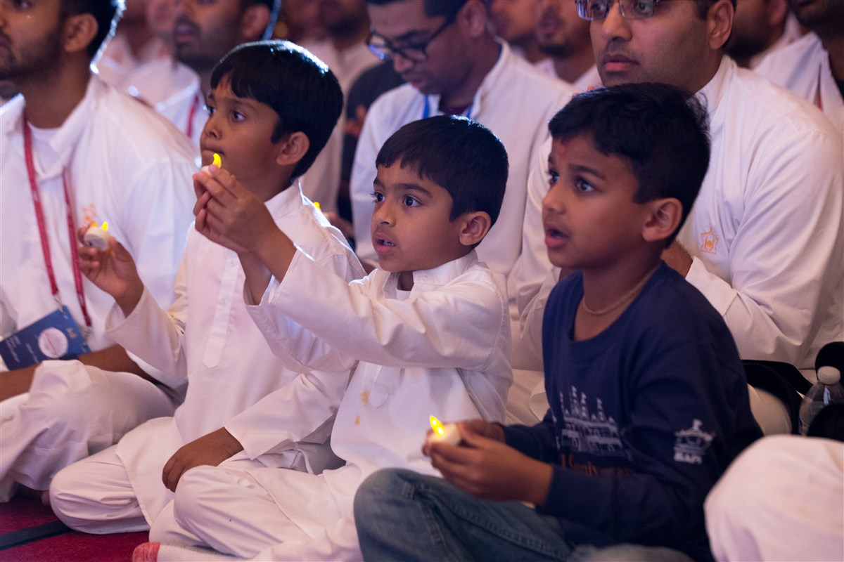 Children participate in the evening arti