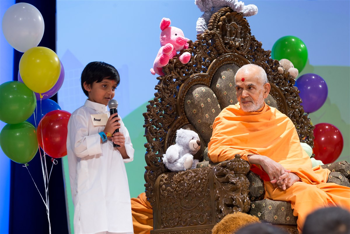 Swamishri attentively listens to a child