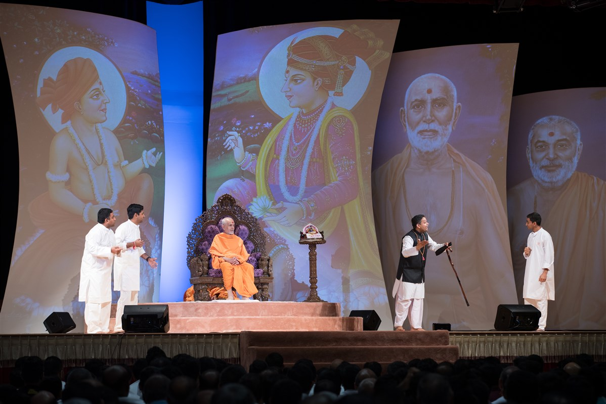 Youths perform a skit before Swamishri, 2 July 2017