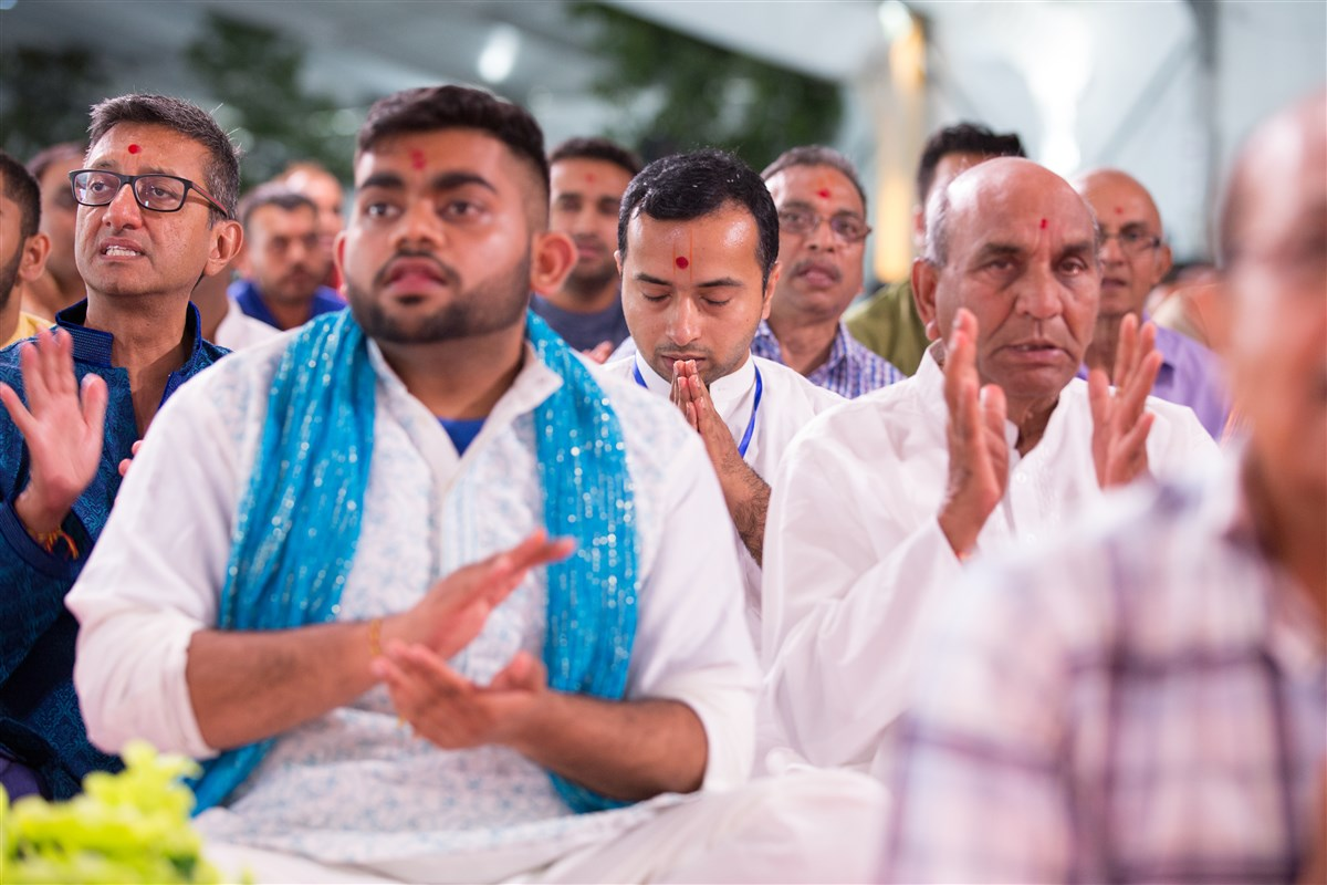 Devotees engaged in the arti