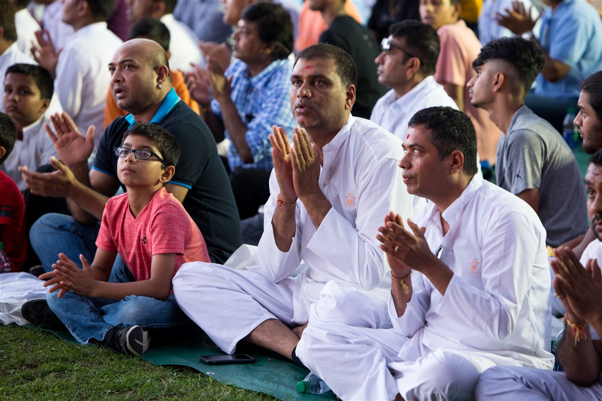 Devotees engaged in the program