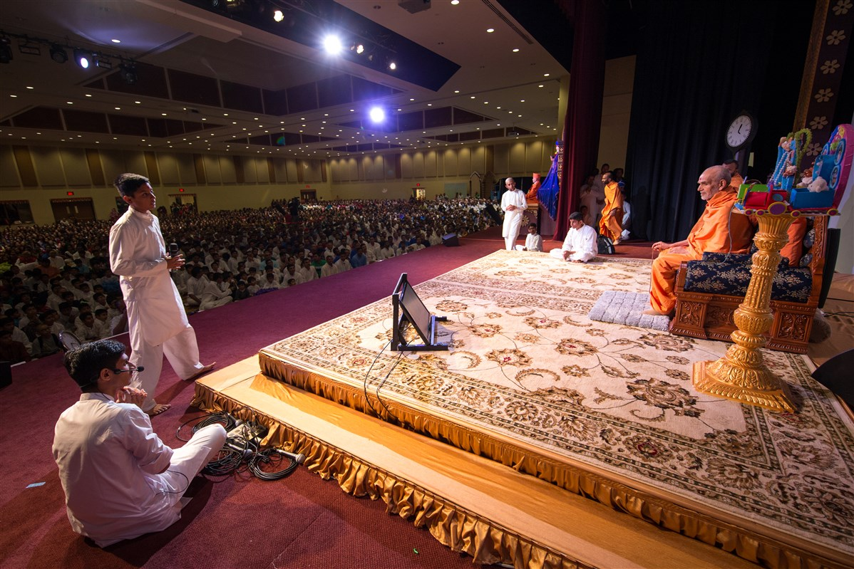 Swamishri engaged in the program