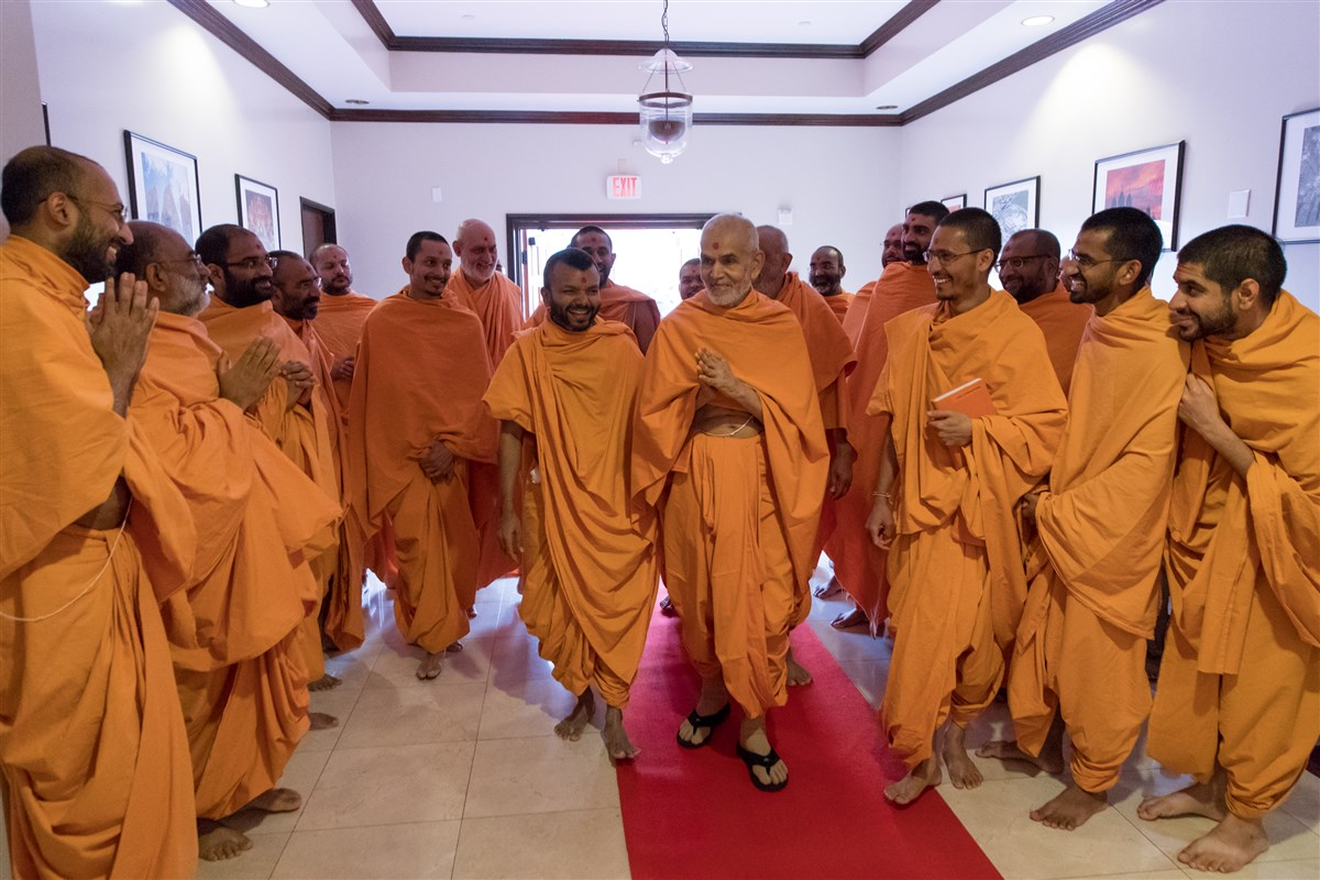 Swamishri greets Swamis with folded hands