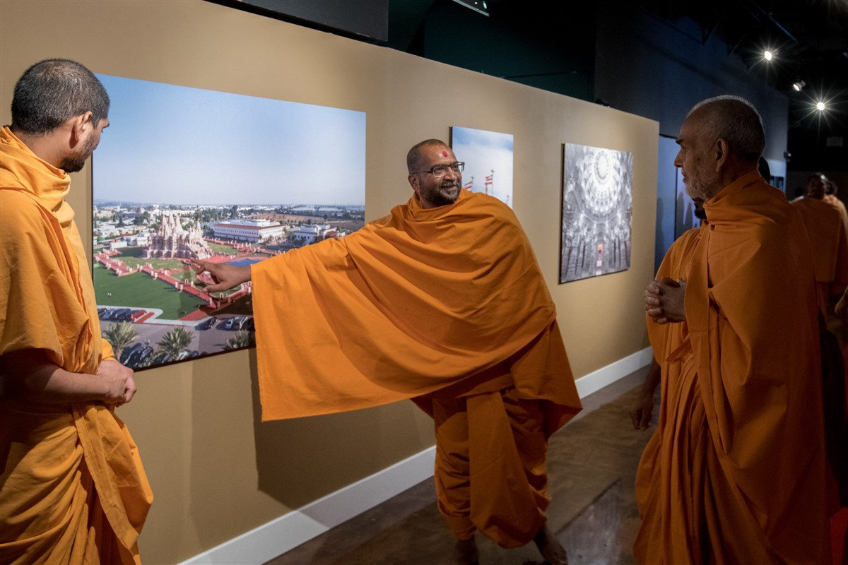 Swamishri views historical pictures of the BAPS Shri Swaminarayan Mandir, Los Angeles, CA, USA