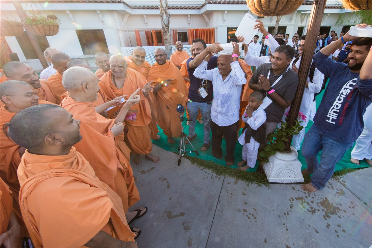 Relating to Swamishri's discourse on dhiraj (patience), devotees keep slab of ice on their head