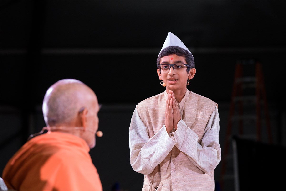 Children perform a skit before Swamishri