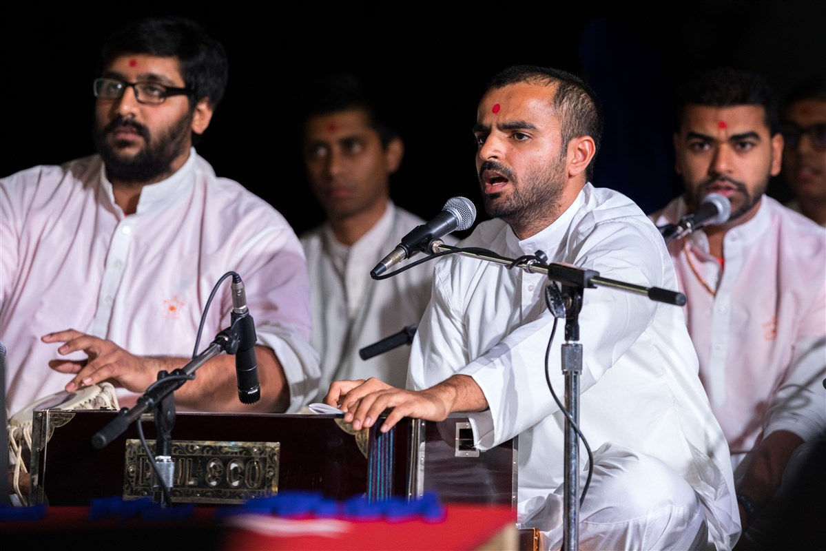 Youths sing kirtans during puja
