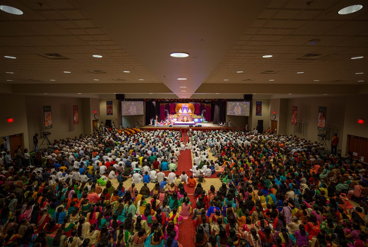 Devotees engaged in the evening assembly