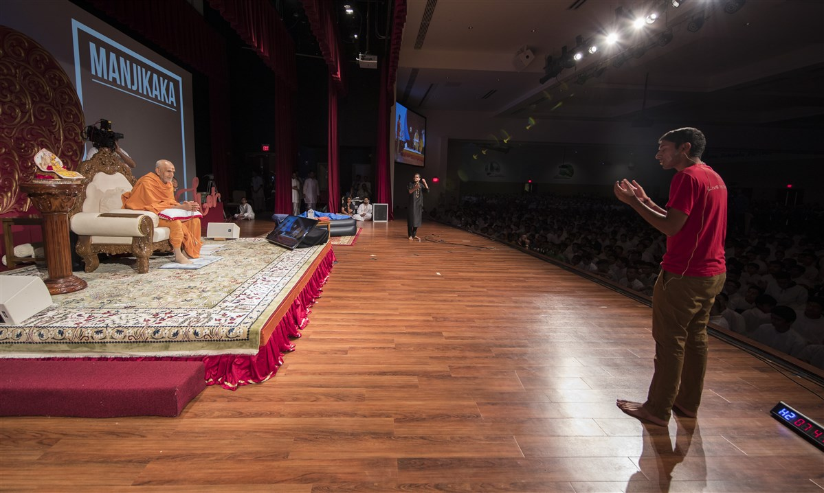 Youths perform a skit before Swamishri