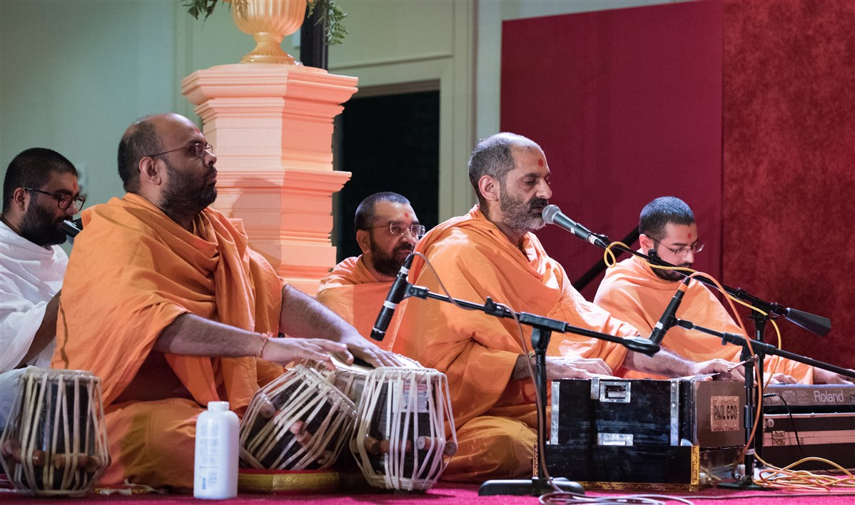 Swamis sing kirtans during puja