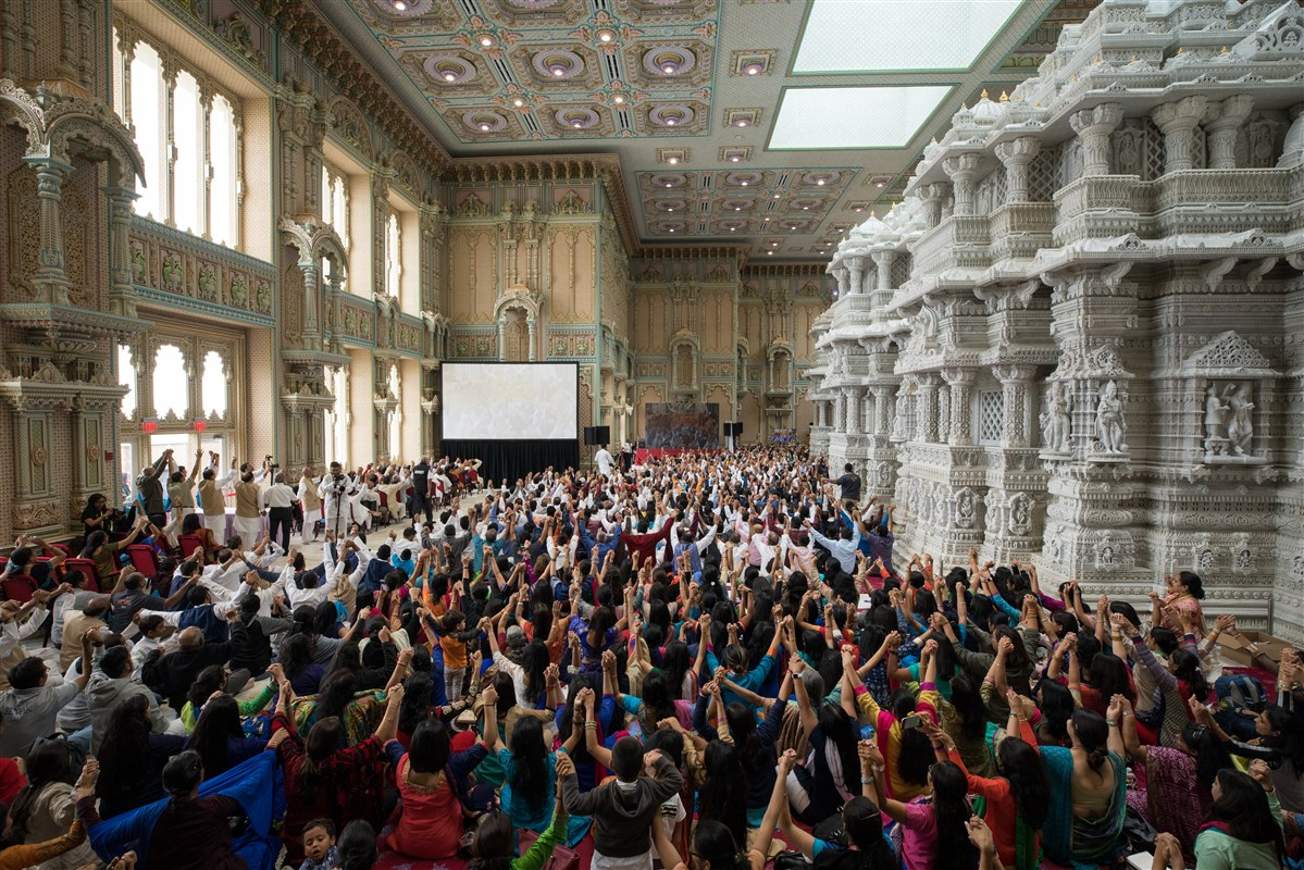 Devotees joins hands in a gesture of unity