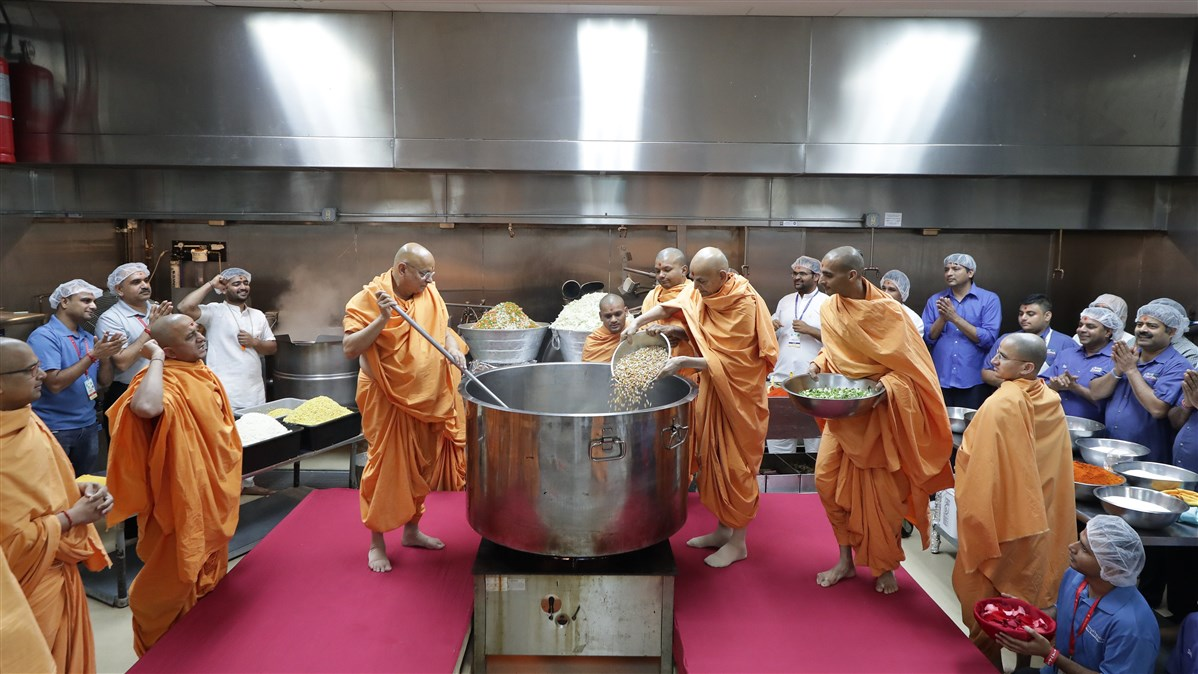 Swamishri makes khichdi which was served to the devotees during HH Pramukh Swami Maharaj's Asthipushpa Visarjan later in the evening