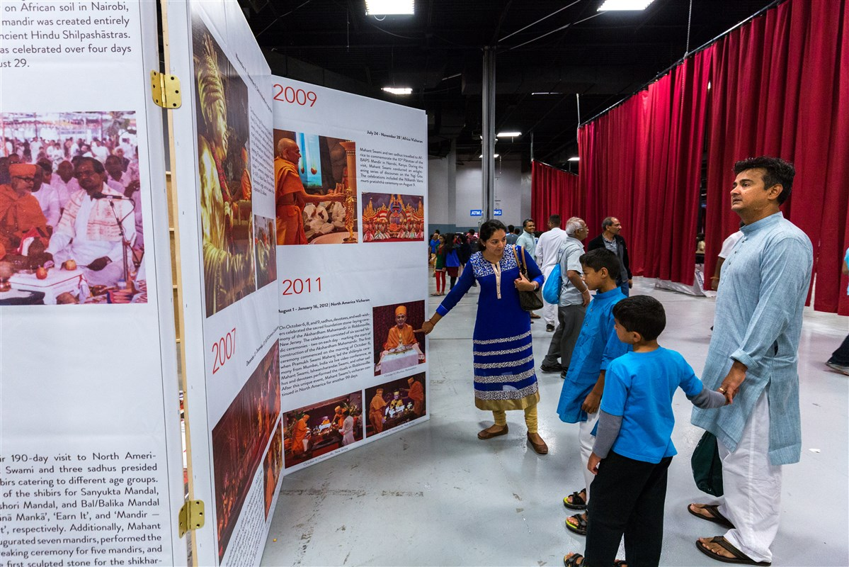 Families view an exhibition at the Convention Center