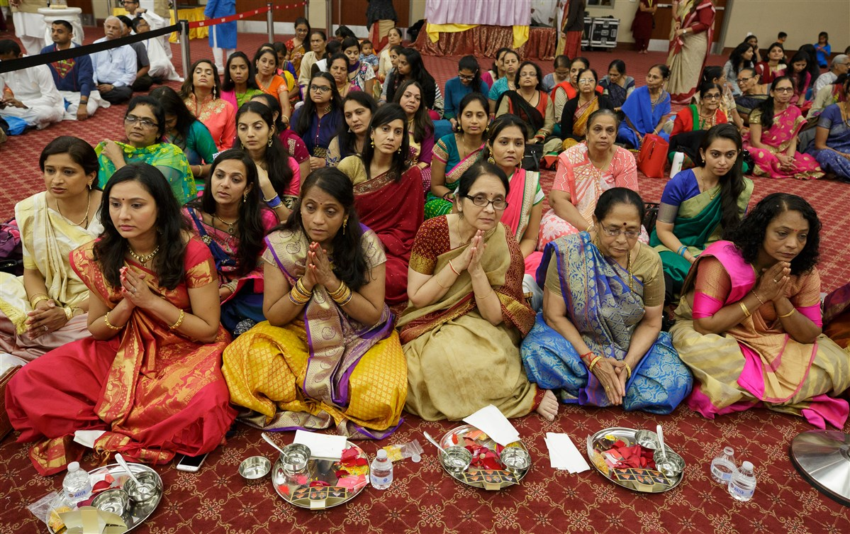 Mothers of the sadhaks participate in mahapuja rituals