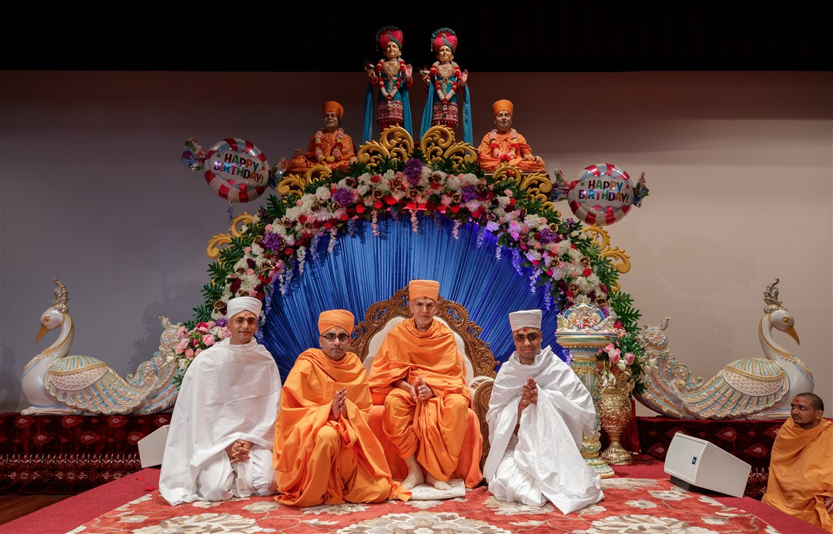 Swamishri with a newly initiated parshads and swami