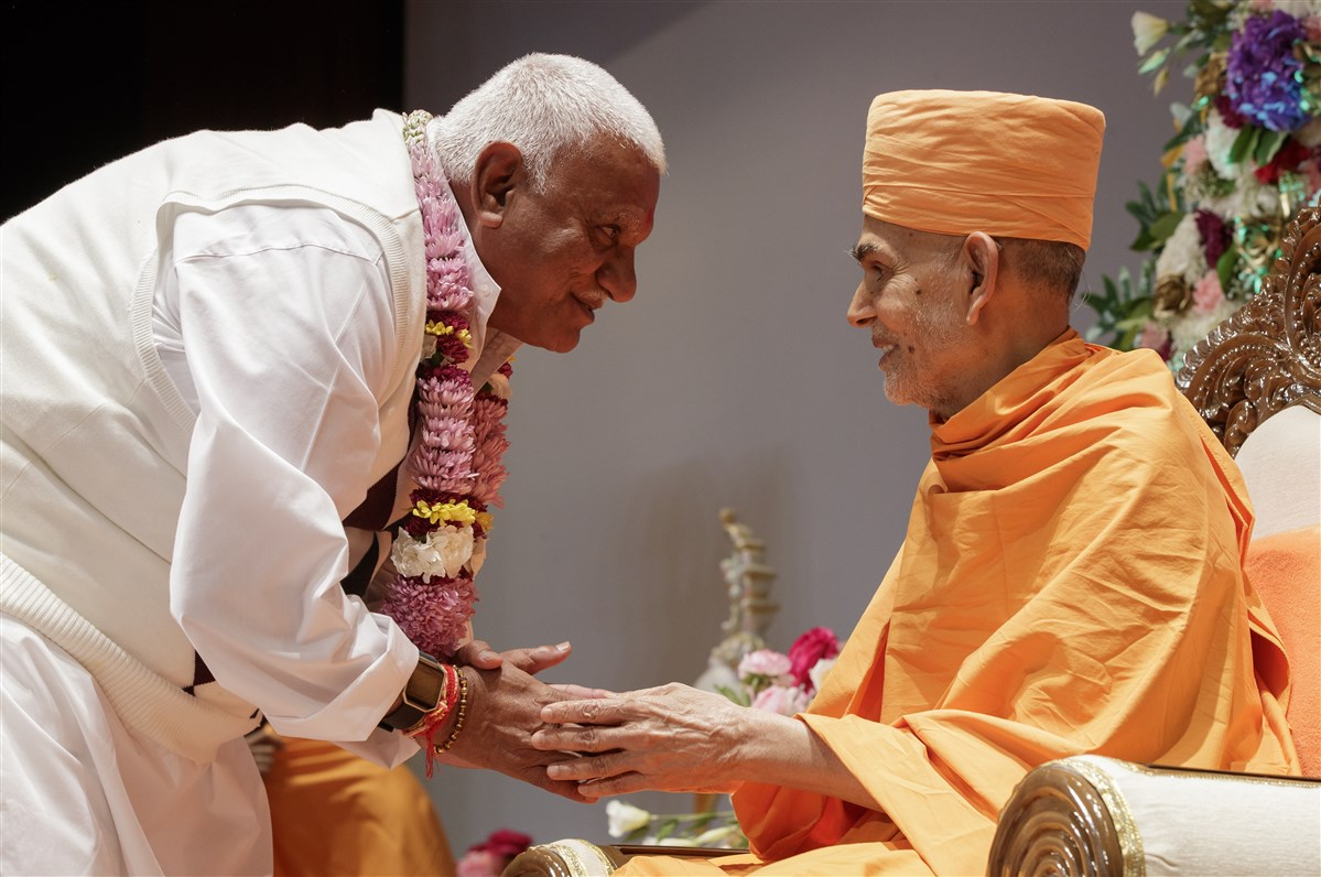 Swamishri blesses the family of the youths who received diksha