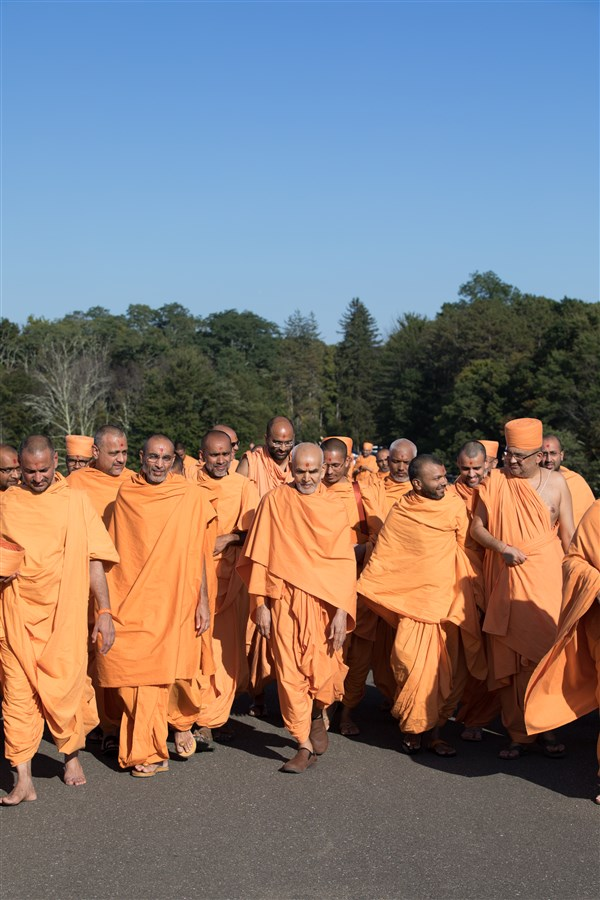 Swamishri engaged in his afternoon walk during the Sant Shibir, 18 September 2017