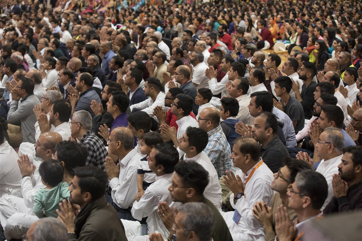 The devotees reciprocate with folded hands