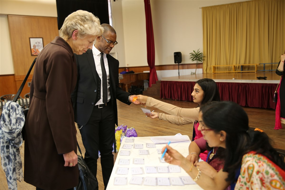 Guests arrive at London Mandir for the Community Day assembly