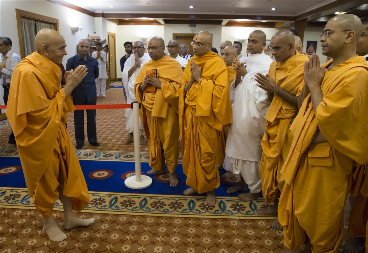 Param Pujya Mahant Swami Maharaj greets swamis with folded hands in the morning