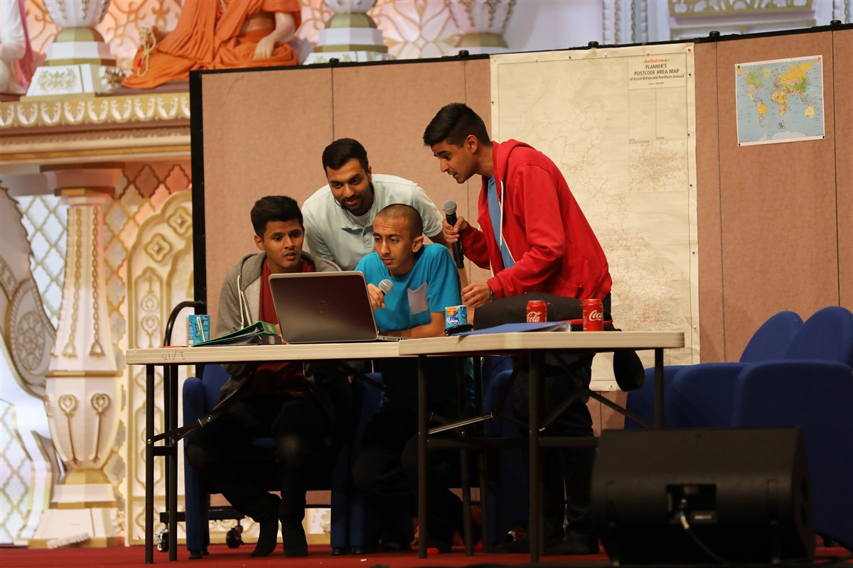 Youths present a skit in the evening assembly introducing the life and work of Pramukh Swami Maharaj